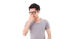 Nerd man thinking, studio shot, white background Stock Photography