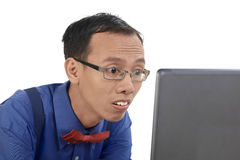 Nerd man using laptop and look concentration using laptop Royalty Free Stock Photo