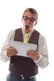 Nerd med hans tablet Royaltyfri Fotografi