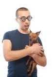 Nerd och hund arkivbild