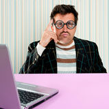 Nerd pensive man glasses silly expression laptop. Nerd pensive man with myopic glasses and silly expression searching a solution in laptop computer Royalty Free Stock Photos