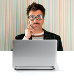 Nerd pensive man glasses silly expression laptop Stock Photo