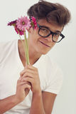 Nerd with pink flowers Royalty Free Stock Photo