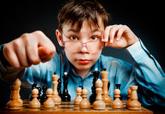 Nerd play chess Stock Photography