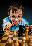 Nerd play chess Royalty Free Stock Images