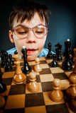 Nerd play chess Stock Photo
