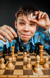 Nerd play chess Stock Image