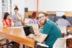 Nerd programmer with laptop. In IT startup Royalty Free Stock Image