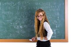 Nerd pupil blond girl in green board schoolgirl Royalty Free Stock Photography