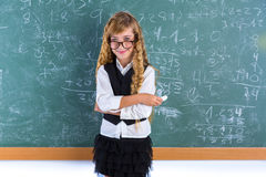 Nerd pupil blond girl in green board schoolgirl Royalty Free Stock Photos