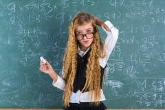 Nerd pupil blond girl in green board schoolgirl Stock Photos
