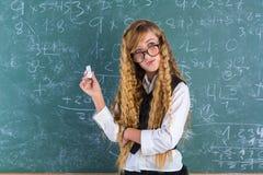 Nerd pupil blond girl in green board schoolgirl Royalty Free Stock Photo