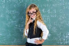 Nerd pupil blond girl in green board schoolgirl Royalty Free Stock Image