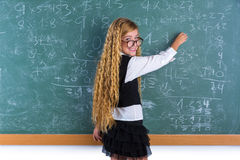 Nerd pupil blond girl in green board schoolgirl Stock Photography