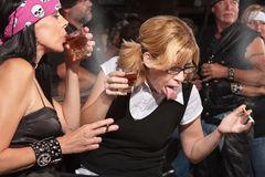 Nerd Reacting to Alcohol in Bar Stock Images