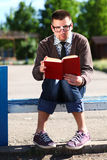 Nerd reading book Stock Image