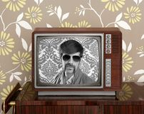 Nerd retro 60s vintage wooden tv presenter Stock Photos