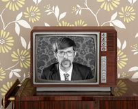 Nerd retro 60s vintage wooden tv presenter Stock Photography