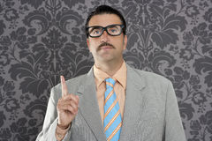 Nerd retro businessman raising finger up Royalty Free Stock Photos