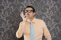 Nerd retro man businessman ok positive. Hand gesture wallpaper background Royalty Free Stock Image