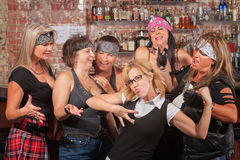 Nerd Showing Off For Female Gang Royalty Free Stock Photography