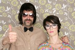 Nerd silly couple retro man woman ok hand sign. Nerd silly couple tacky retro 60s man woman ok hand sign floral wallpaper stock images