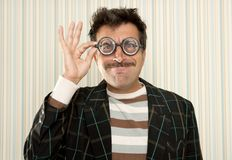 Nerd silly crazy myopic glasses man funny gesture. Mustache tacky retro Stock Photo