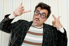 Nerd silly crazy myopic glasses man funny gesture. Mustache tacky retro Stock Photography