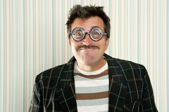 Nerd silly crazy myopic glasses man funny gesture. Mustache tacky retro stock images