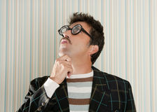 Nerd silly crazy myopic glasses man funny gesture. Mustache tacky retro Royalty Free Stock Image