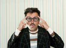 Nerd silly crazy myopic glasses man funny gesture. Nerd silly myopic man with glasses thinking doing funny gesture with retro mustache Stock Photography