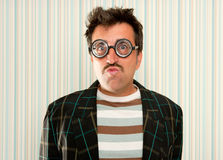 Nerd silly crazy myopic glasses man funny gesture Stock Photos