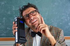 Nerd silly private investigator retro walkie talkie Royalty Free Stock Photography