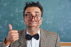 Nerd silly retro man with braces funny expression. Nerd silly retro teacher man with braces funny expression ok thumb up gesture Stock Image