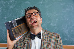 Nerd silly retro man with braces and vintage radio Royalty Free Stock Photo