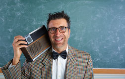 Nerd silly retro man with braces and vintage radio Stock Images