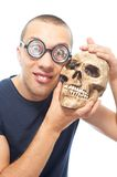 Nerd and skull Stock Images