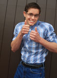 Nerd smiling giving 2 thumbs up royalty free stock images