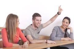 Nerd steekt zijn hand op Stock Fotografie