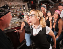 Nerd Sticking Out Tongue in Bar Stock Image