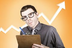Nerd stock market analyst writing finance report Royalty Free Stock Images