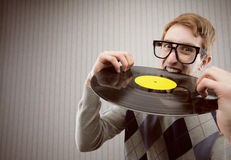 Student angry, biting a vinyl record. Nerd student angry, biting a vinyl record stock photos