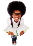 Nerd student with a notebook Stock Image