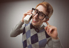 Nerd man with an old mobile phone Royalty Free Stock Photography