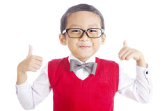 Nerd student and thumbs-up. Portrait of asian elementary school student and thumbs-up. shot in studio isolated on white Royalty Free Stock Photos