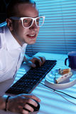 Nerd surfing internet at night time Stock Photography
