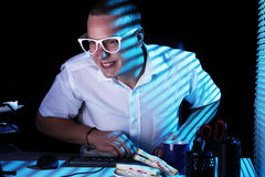 Nerd surfing internet at night time Stock Photos