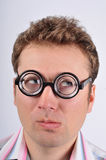 Nerd thinking. Happy nerd in funny glasses. Expression - confusion Royalty Free Stock Photos