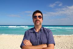 Nerd tourist mustache on caribbean beach Stock Photography