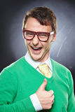 Nerd wearing eyeglasses showing thumbs up sign. Stock Photo